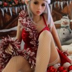 Dora Sex Doll posing for a sex doll Christmas at a Dirty Knights photoshoot 1